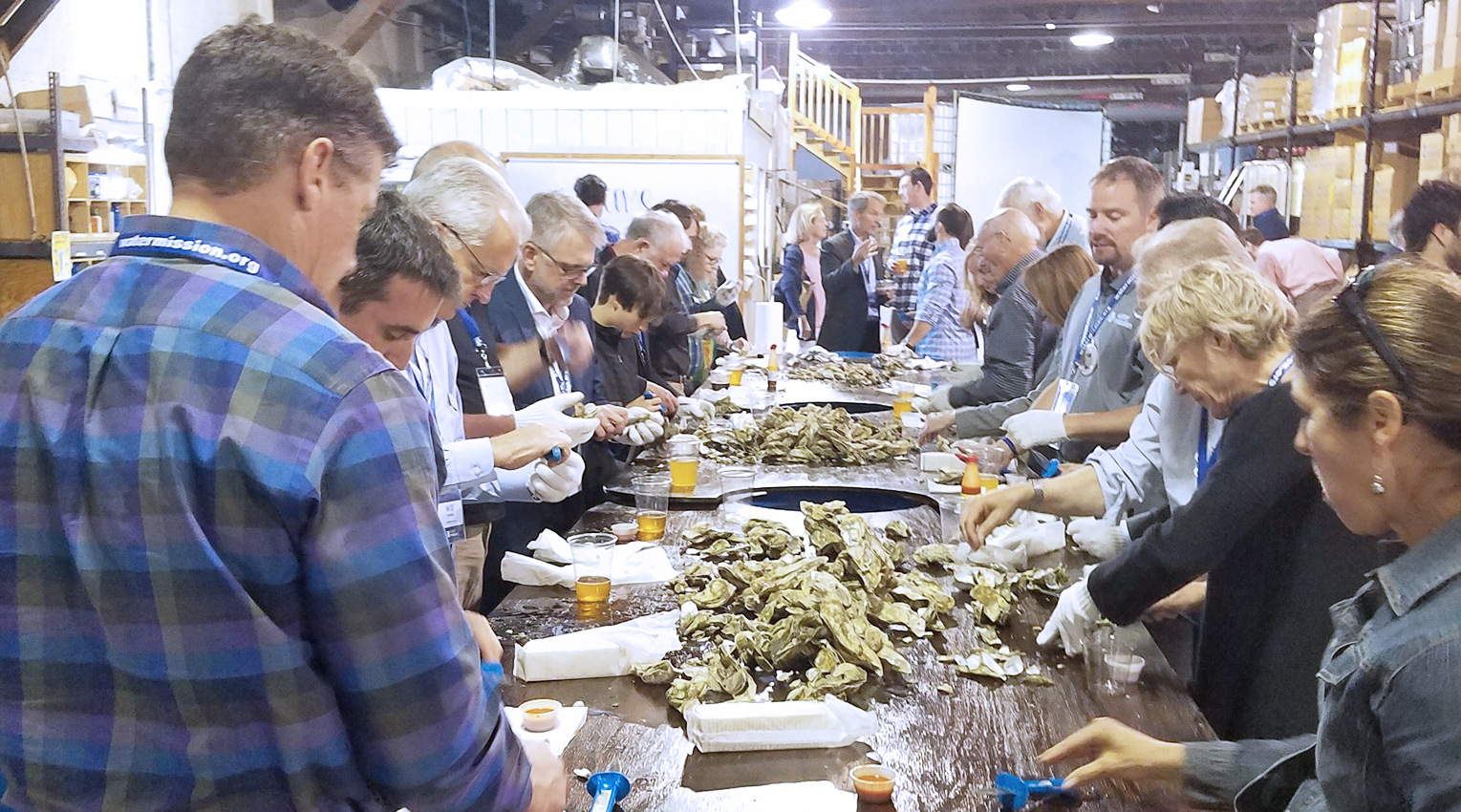 people enjoying oysters at an oyster roast in charleston sc